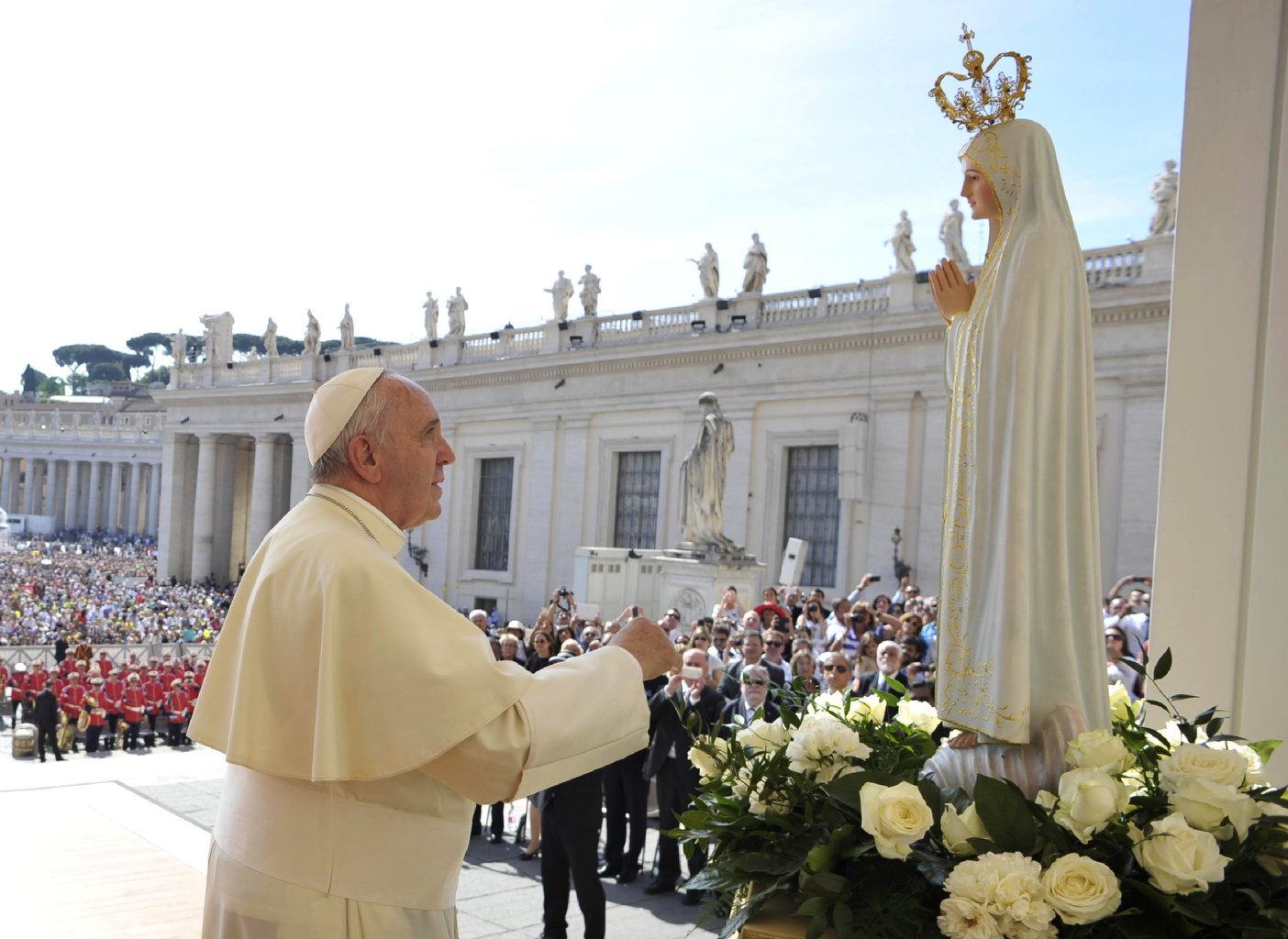Pope Francis prays in front of statue of Our Lady of Fatima during general audience in St. Peter's Square at Vatican
